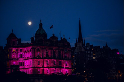 Edinbutgh lit up pink at The MoonWalk Scotland