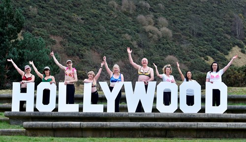 Image of Walkers holding 'Hollywood' letters in bras